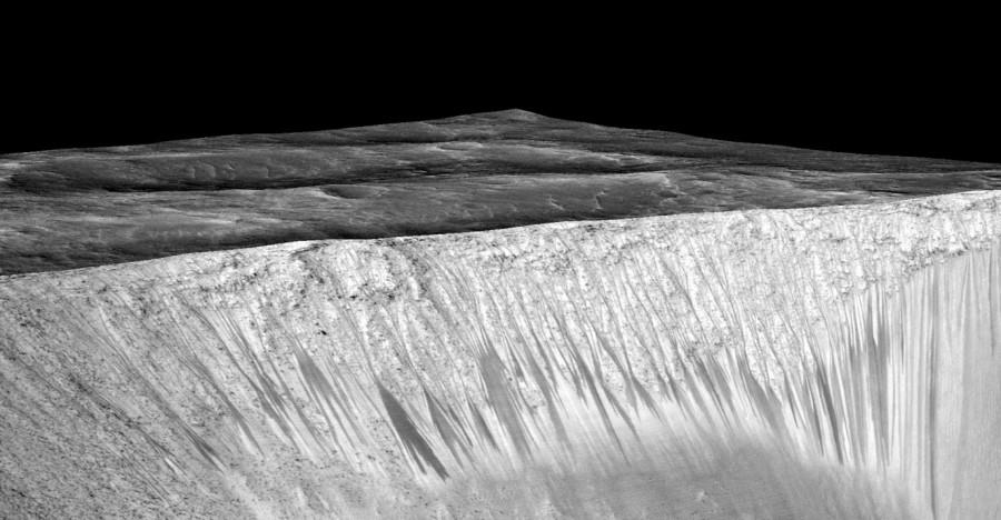 Long narrow streaks containing perchlorates. Image attributed to NASA.