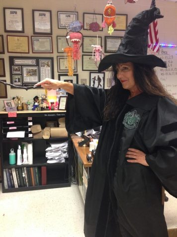 Dr. Jezequel dressed in Slytherin robes, her wand at the ready.